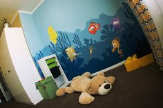 Nursery with wall painting and decals of sea world I illustrated. If you like it you can find more animals on my facebook page