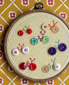 adorable bikes with button wheels #buttons #embroidery I think it is a great idea and you could do it with flowers and bugs and things.