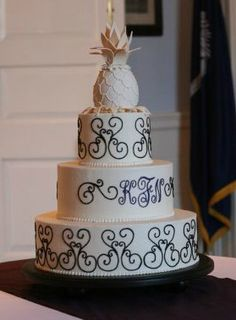 Buttercream Wedding Cake With Iron Gate Scroll Work And A Pineapple Topper