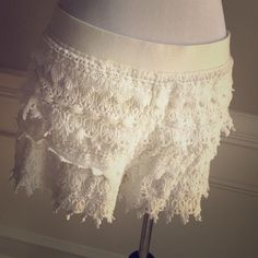 Express Lace White/ Cream Shorts Express whitish cream lace crochet shorts. Wore once. Too big for me now. Size large. Extremely comfortable and soft. No flaws or defects at all! Express Shorts