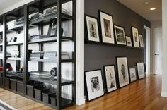 Home Tour: Trey Russell: Russell used Pottery Barn shelving to showcase his collection of black-and-white photographs as well as taking by Pinky and the Brain