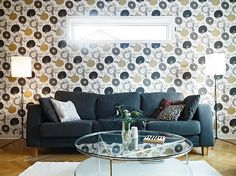 Gray and taupe floral wallpaper with gray sofa.  Cute living room!