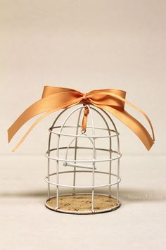 An idea on what to do with those thrift store bird cage votive holders...just add a simple bow after spraypainting them...