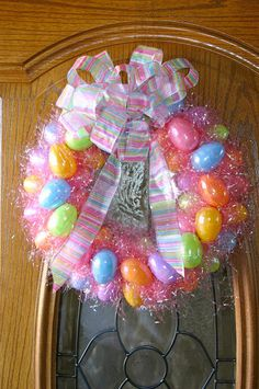 Easter Wreath Tutorial using plastic eggs and easter grass. Adorable and easy
