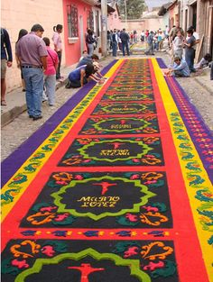 Rugs made painstakingly out of flower petals and coloured sawdust take weeks to make.  They are spread across the streets of Antigua, Guatemala for Holy Week.  Beautiful, fragile works of art.