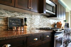 Kitchen, The Nice Design Of Backsplash For Kitchen With Gray Color Of Glass Tile Backsplash With Wooden Brown Cabinet And White Wall With White Roof Also Brown Granite Countertop: Design of the Discount Glass Tile Kitchen Backsplash Ideas