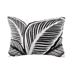 The Echo Design™ Kalea bedding collection features a bold black and white tribal print that creates a dramatic look in your bedroom. The oblong pillow features an embroidered leaf pattern that coordinates with the rest of the bedding ensemble.