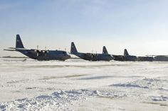 Staff Sgt. Lealan Buehrer/Air Force Air Force C-130H3 Hercules planes sit parked Monday during bitterly cold weather conditions at the 182nd Airlift Wing in Peoria, Ill. The Illinois Air National Guard base experienced minus 35 degrees Fahrenheit wind chills and wind gusts of up to 36 mph Monday when an Arctic air mass crossed the central and eastern U.S., according to the National Weather Service, but the installation remained open and ready to complete its state and federal missions.