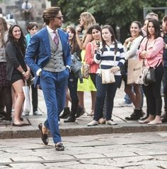 Blue suit, grey waistcoat and brown tasseled loafers