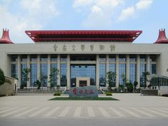 The new Yunnan Museum of Literature and Art across the road from the Provincial Museum is 13 kilometers south of Kunming, Yunnan, China. The building is impressive but largely empty. Kunming, Empty, Literature, Multi Story Building, Museum, China, Mansions, Stone, House Styles