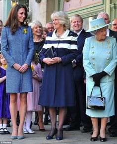 Studies in blue: The duchess of Cambridge, the duchess of Cornwall, the Queen.