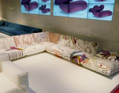 I would love to purchase some Ikea couches and fabric paint and let my kids do an art project like this for our den!
