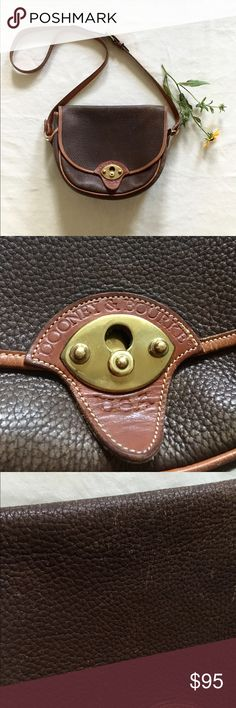 Vintage Dooney and Bourke Cavalry Bag Gorgeous chocolate brown Crossbody with tan trim. Authentic Dooney and Bourke. Well loved, wear shown around edges where leather has lightened a bit but excellent condition for a vintage bag. Please remember this is a beautiful vintage item, so wear is normal. No stains, rips or tears. Offers encouraged! Dooney & Bourke Bags Crossbody Bags