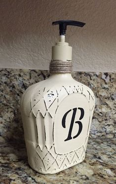 Monogram Crown Royal Bottle soap dispenser Available on Etsy shop my store Royaltyinabottle ***Customize your own*** (Liquor Bottle Art) Liquor Bottle Crafts, Wine Bottle Art, Diy Bottle, Liquor Bottle Lights, Empty Liquor Bottles, Bottle Lamps, Upcycled Crafts, Diy Crafts, Decor Crafts