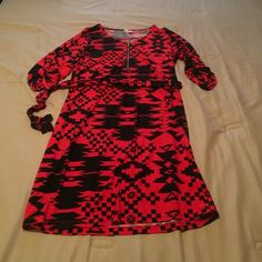 Black & Red Aztec dress Cute dress! Bought from a boutique. Tie around the waste, has a zipper on the front. Sleeves are 3/4 roll up look with buttons Dresses