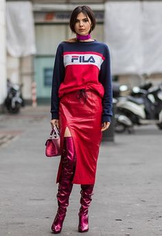 Doina Ciobanu wearing Vetements satin over-the-knee boots with a Fila sweatshirt and a leather thigh-slit skirt.