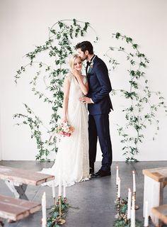 Organic greenery ceremony site || wedding ceremony ideas || bench ceremony seating || candlelit aisle || greenery on wall || wedding backdrop