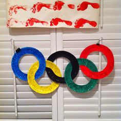 We made this Olympic Ring decoration with paper plates, paint, and glitter