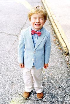 Adorable little boy dressed in seersucker and a vineyard vines bowtie
