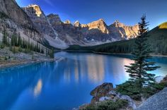 Moraine Lake is located in Banff National Park, Canada. Village of Lake Louise, Alberta is situated 14 kilometres (8.7 mi) from it. Moraine Lake is famous for its blue color and the amazing surroundings: high mountains with snowy peaks create the desired tranquility. Many hiking tracks are trod by visitors from all around the world. The tourism agencies also organize hiking groups and provide equipment.