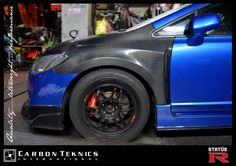 Blue FD2R with carbon fiber Js style hood and lip and Feels style fenders. Photo 04