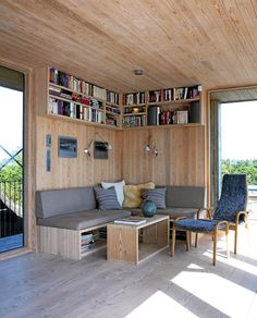 Sofa in the corner is built on low shelves where owners can store magazines and books, and therefore avoid clutter on the coffee table.