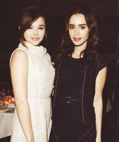 Lily Collins & Chloe Mortez at the Chanel Pre-Oscar Dinner in Los Angeles. February 23, 2013.