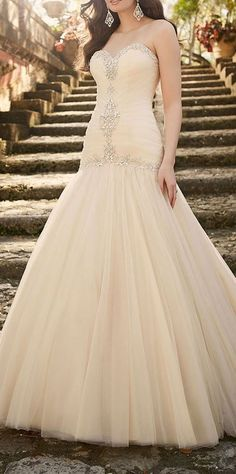 An elegant tulle over satin bridal gown courtesy of the Essense of Australia wedding dress collection