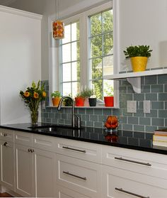 Whisper Green tile backsplash, cambria quartz dark counter, white cabinets. Kitchen Remodel - Jorge contemporary kitchen
