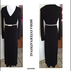"""Price ⬇️ Moda International Black Dress Price dropped for $1.99 shipping! Use the buy now feature. Beautiful long Black dress by Moda International. Belt not included. V-Neck, long sleeves. Built in shelf bra. 70% Rayon 30% Polyester  100% Nylon lining. Bust 17"""" Length 56"""". Made in USA Moda International Dresses"""