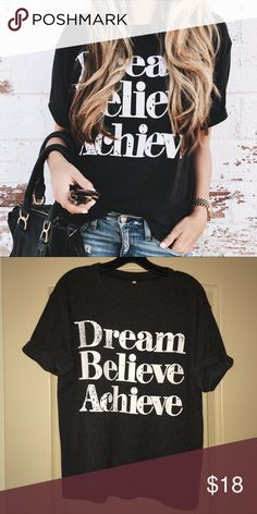 Dream Believe Achieve Graphic Tee Like new condition - only worn a couple times. Fits true to size - like a relaxed t-shirt.  Looks black - but is a dark gray. No trades // No PayPal. Etsy Tops Tees - Short Sleeve