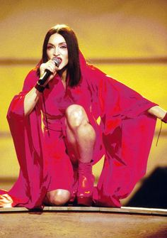 Pin for Later: The 50 Most Iconic Grammys Outfits of All Time Iconic Grammys Style Madonna hit the stage in a red cape during the 1999 show.