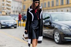 Viviana Volpicella weark a black fur coat and bag seen outside Gucci during Milan Fashion Week Fall/Winter 2016/17 on February 24, 2016 in Milan, Italy