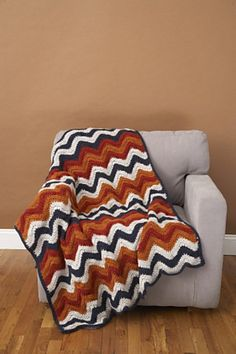 Ravelry: Ripple Afghan Camden Throw; free pattern.  I'm digging the Auburn colors and the edging.