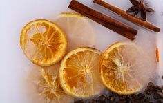 Orange fresh closed in candle with cinnamon sticks.