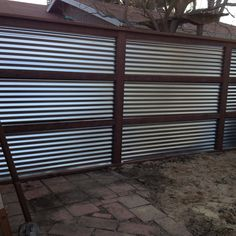 Galvanized Corrugated Metal And Treated Wood Feature Wall Outdoor Corregated Metal, Corrugated Metal Fence, Metal Roof, Metal Fences, Galvanized Metal, Horse Fencing, Privacy Fence Designs, Privacy Fences, Backyard Fences