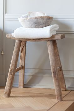 Rustic wooden stool in the bathroom