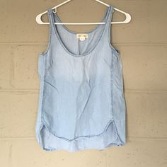 Anthropologie Distressed Jean Tank Anthropologie Dostressed Jean Tank. Size XS. 100% Tencel. Excellent condition - worn and washed once! Just too small on me. I purchased on sale rack, which reflects low price. Last photo is the same top in a different color to show style. Anthropologie Tops Tank Tops