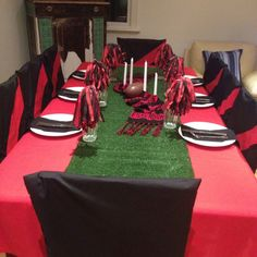 Fathers day table setting AFL Essendon themed. Had Scoreboard on the wall and served footy style food - pies, hotdogs, chips etc