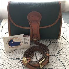 Near Mint Vintage Dooney & Bourke Medium Essex Fir Near Mint Vintage Dooney & Bourke Medium Essex in Fir & British Tan. Beautiful, near flawless collector's piece. Has original purchase tags. Serious inquiries only, price firm! Dooney & Bourke Bags Shoulder Bags