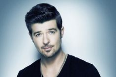 Robin Thicke . I want his pictures all over my bedroom walls.. Don't know how my husband would feel about that though lol
