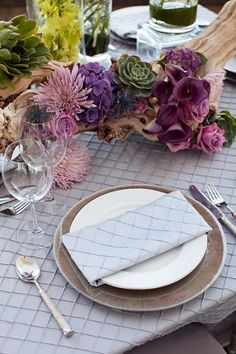 love what's on the table- table scape? i like the purple and soft textures (hate the table cloth).