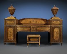 A  stunning masterpiece of artistry and craftsmanship. Constructed of high quality satinwood boldly cross-banded with rich mahogany, this stunning sideboard embodies the Neoclassical Adams Style.