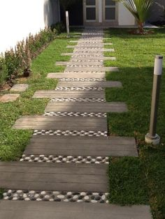 I like the alternating concrete and stone walkway. I'd do it without the staggered effect.
