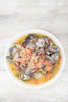 This Spicy Clam and Kale Appetizer is rich in flavor, full of clams, garlic, tomatoes, bacon and kale. It's the perfect appetizer for two!