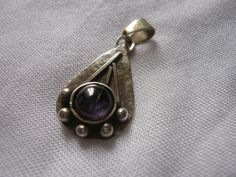 Sterling silver pendant with iolite on a by MergruenDesigns