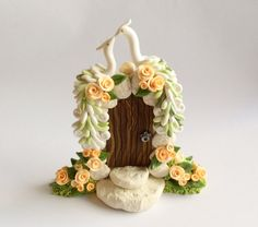 white peacock wedding cake topper with peach roses by fizzyclaret