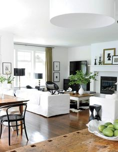 Living room design: Black decor accessories in an all-white living room {PHOTO: Tracey Ayton}