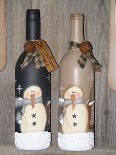 These wine bottles were base coated with spray paint then painted with this adorable Marie Provost design. Each bottle has a piece of homespun