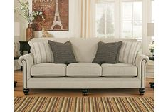 Milari sofa masters the art of smart and sophisticated style. Linen-like upholstery exudes such a crisp, clean sensibility, while nailhead trim really plays up the flow and flair of rolled arms. Turned bun feet in a rich, dark finish are a brilliant complement.